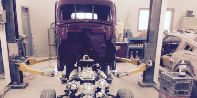 Dave's 1948 Ford Anglia body going back on the frame