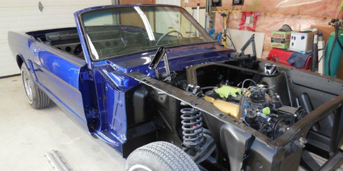 Putting in the Motor of the 1965 Ford Mustang